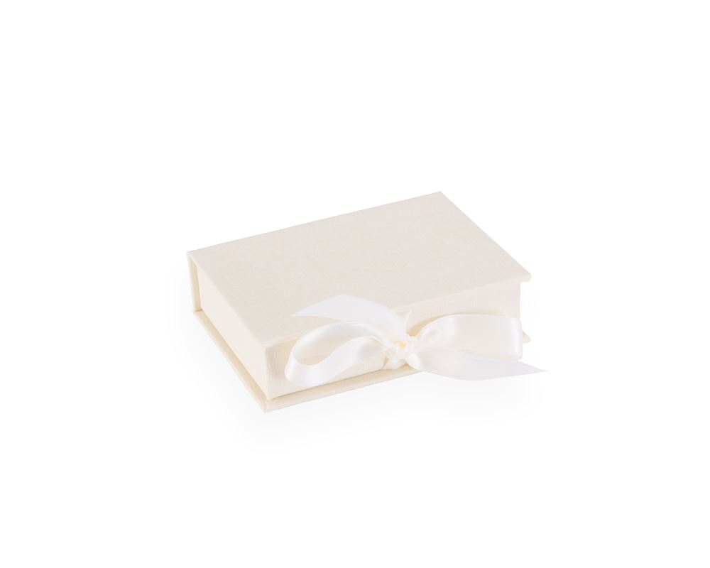 box with silk ribbons, ivory