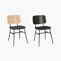 Barney stol, svart kunstlær, sorte metallben, svart eller hvit pigmentert rygg